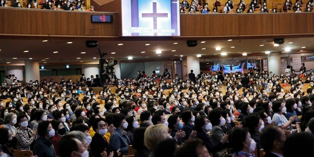 Christians wearing face masks attend a service at the Yoido Full Gospel Church in Seoul, South Korea, Sunday, May 10, 2020.