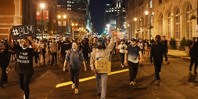 Protesters rally as they march through the streets on May 29 in St Louis, Missouri.