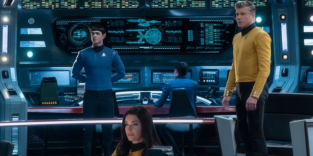 This image released by CBS All Access shows, from left, Ethan Peck as Spock, Rebecca Romijn as Number One, and Anson Mount as Captain Pike of the the CBS All Access series