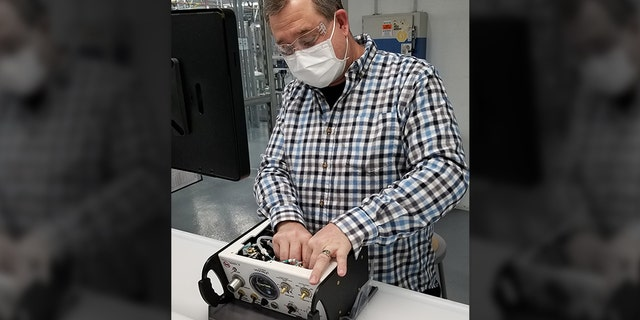 President Trump will visit Ford Motor Company's Rawsonville plant in Michigan on May 21, 2020, which is making ventilators for the coronavirus pandemic. Ford employee Terry Bowman is seen here working on a ventilator.