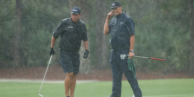 Phil Mickelson, left, and Tom Brady during the charity match Sunday. (Mike Ehrmann/Getty Images for The Match)