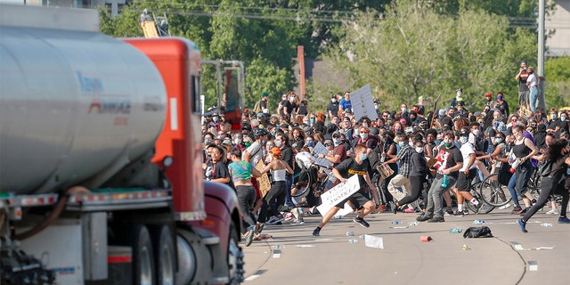 A tanker truck drives into thousands of protesters marching on 35W north bound highway during a protest against the death in Minneapolis police custody of George Floyd, in Minneapolis, Minnesota, U.S. May 31, 2020.
