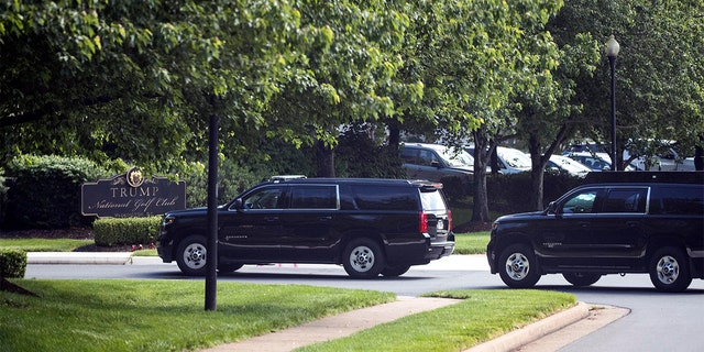 The motorcade for President Donald Trump arrives at Trump National Golf Club, Saturday, May 23, 2020, in Sterling, Va.