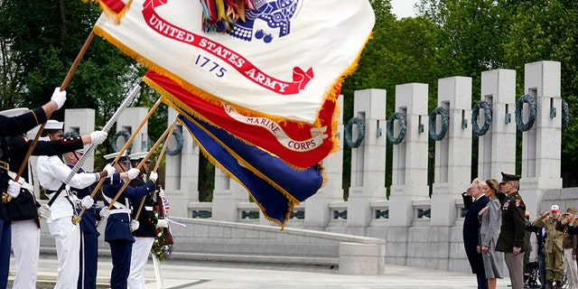 President Donald Trump and first lady Melania Trump participate in a ceremony at the World War II Memorial to commemorate the 75th anniversary of Victory in Europe Day, Friday, May 8, 2020, in Washington. (AP Photo/Evan Vucci)