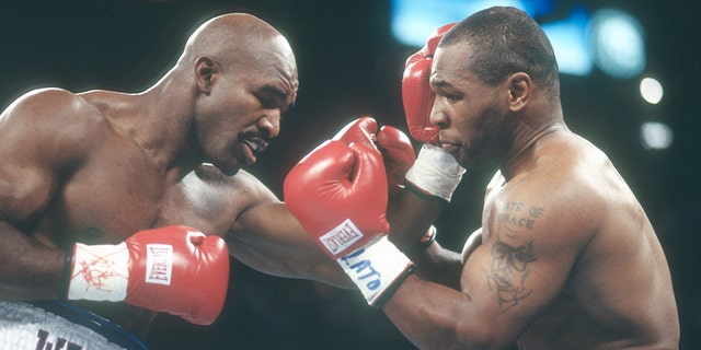 LAS VEGAS, NV - JUNE 28: Evander Holyfield and Mike Tyson fight for WBA World Heavyweight Title on June 28,1997 at the MGM Grand Garden in Las Vegas, Nevada. The Fight was stopped in the third round and Tyson was disqualified for biting Holyfield on both ears. (Photo by Focus on Sport/Getty Images)