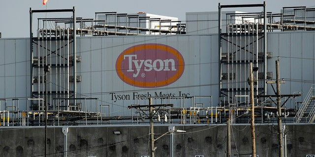 A Tyson Fresh Meats plant is seen Monday, April 27, 2020, in Emporia, Kan. President Donald Trump plans to order meat processing plants to stay open amid concerns over growing coronavirus cases and the impact on the nation's food supply. (AP Photo/Charlie Riedel)