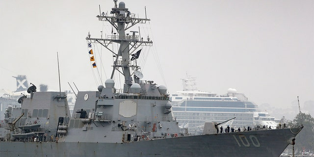 The USS Kidd flies its traditional skull and crossbones flag while passing downtown San Diego as it returns to Naval Base San Diego, Tuesday, April 28, 2020, as seen from Coronado, Calif. - file photo.