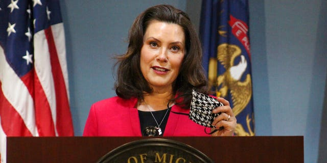 FILE - In this Thursday, May 21, 2020 file photo provided by the Michigan Office of the Governor, Michigan Gov. Gretchen Whitmer speeks during a news conference in Lansing, Mich. (Michigan Office of the Governor via AP, Pool)