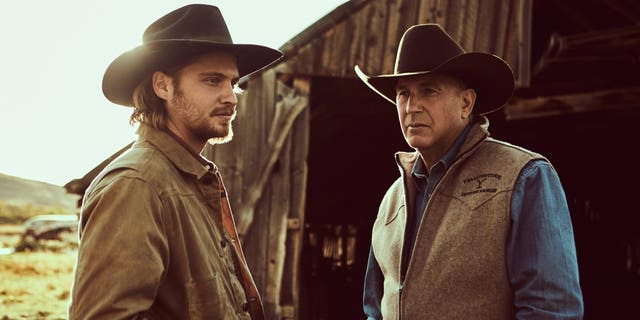 Kevin Costner (R) as John Dutton and Luke Grimes (L) as Kayce Dutton.