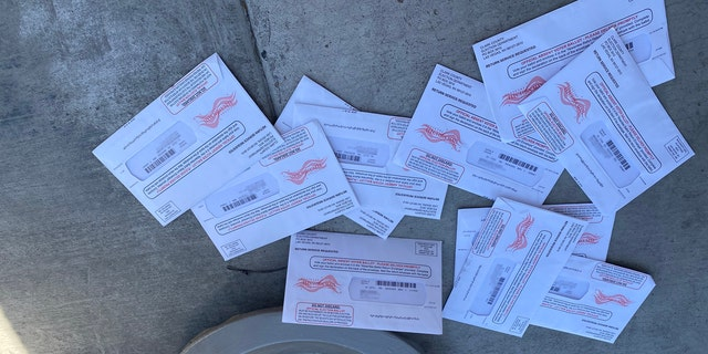 Ballots laying on the sidewalk outside an apartment complex in Las Vegas. (Photo Courtesy of Jim M.)