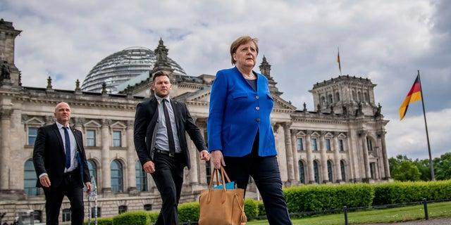 Merkel says have `hard evidence` on Russian hackers targeting her