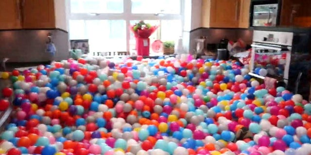 Joel Conder filled his house with 250,000 balls as a surprise for his family.