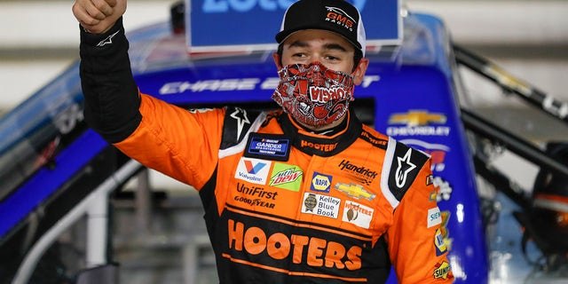 Chase Elliott celebrates after winning the NASCAR Truck Series auto race at Charlotte Motor Speedway Tuesday, May 26, 2020, in Concord, N.C. (Associated Press)