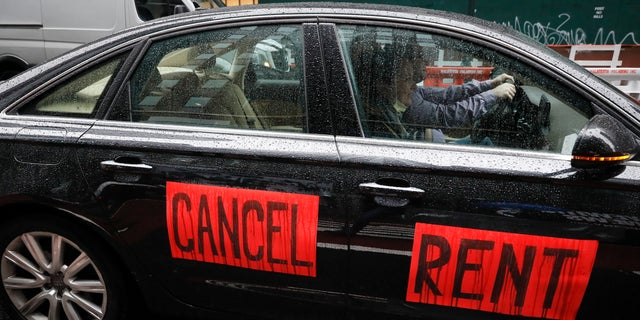 A sign with the message to cancel rent is displayed on a vehicle in New York City. (AP)