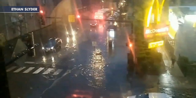 Cars were seen driving through floodwaters after thunderstorms left many parts of the Chicago area inundated with water on May 17, 2020.