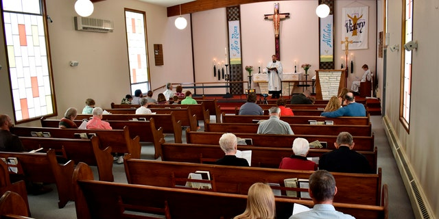 Members of Christ the King Lutheran Church in Billings, Montana sing a hymn during a service Sunday, April 26, 2020. Montana has begun a phase-in reopening of businesses and gathering places as infection rates from the coronavirus decline in the state. (AP Photo/Matthew Brown)