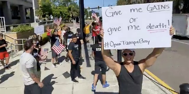 People protest for re-opening the economy at a faster rate outside the Old Pinellas County Courthouse, amid the coronavirus crisis, in Clearwater, Florida, U.S. May 11, 2020 in this still image taken from a social media video. (JOZEF GHERMAN/ FACEBOOK/ OPEN TAMPA BAY/via REUTERS)