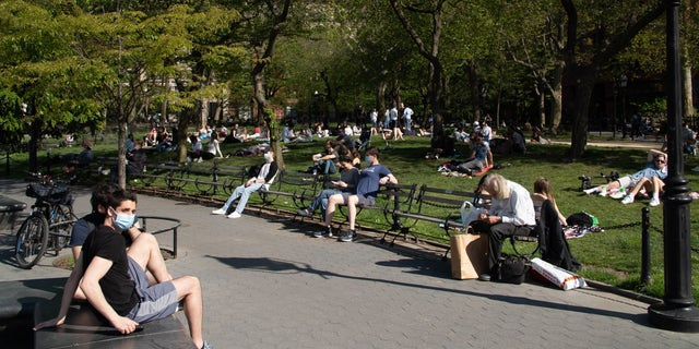New Yorkers flock to Washington Square Park on a sunny day amid the coronavirus pandemic.