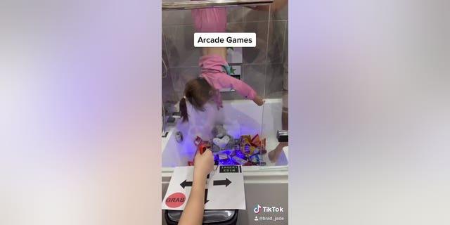 The dad's girlfriend began making TikTok videos to keep his daughters entertained during lockdown.