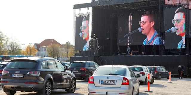Danish singer and songwriter Mads Langer preforms at a sold-out drive-in concert at Tangkrogen in Aarhus, Denmark on April 24, 2020. (Photo by Mikkel Berg Pedersen / Ritzau Scanpix / AFP) / Denmark OUT (Photo by MIKKEL BERG PEDERSEN/Ritzau Scanpix/AFP via Getty Images)