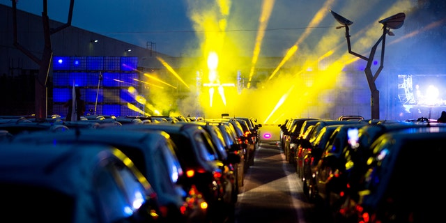 """April 30, 2020, Lower Saxony, Schuttorf: Guests park their cars during a car disco in the parking lot of the disco """"Index"""". This large-capacity discotheque in Grafschaft Bentheim is offering a car disco for the second time. In 250 cars a total of 500 guests can participate. Photo: Hauke-Christian Dittrich/dpa (Photo by Hauke-Christian Dittrich/picture alliance via Getty Images)"""