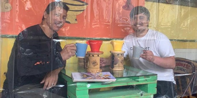 """""""I know it's a little bit weird to come into a cafe full of shower curtains because we are not used to that type of environment,"""" said cafe owner Francini Osorio. """"But the way things are I don't know what else to do."""