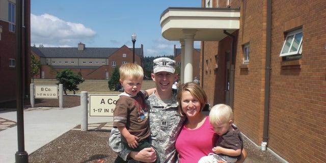 CPT John Hallett and wife Lisa Hallett and their children.