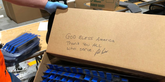 Ford Motor Co. worker leaves a message to the military who will receive their face shields. (Ford Motor Co. photo)