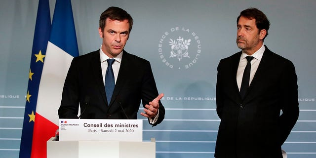 French Minister for Solidarity and Health Olivier Veran, left, and French Interior Minister Christophe Castaner attend a press conference in Paris on Saturday as nationwide confinement to counter the COVID-19 virus continues until May 11 . (AP Photo/Francois Mori, pool)