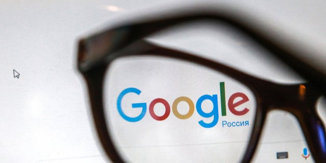 Glasses on a computer screen show the logo and search box of the Google search engine.