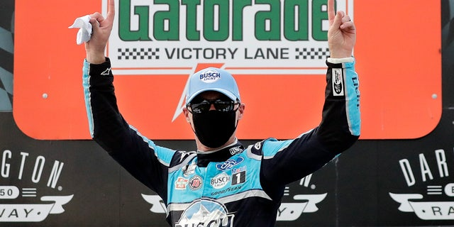 Harvick donned a facemask on the winner's podium in keeping with the health and safety protocols in place at the track.