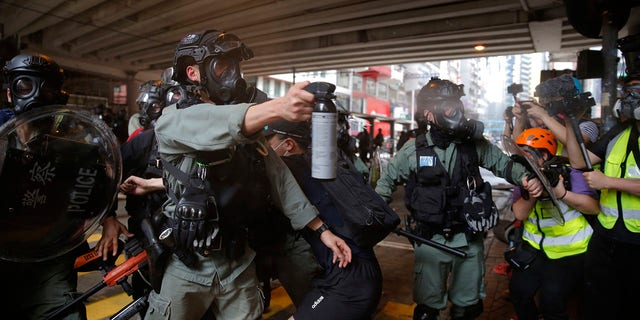 Riot Police use pepper spray on protesters during a protest against Beijing's national security legislation in Causeway Bay in Hong Kong, Sunday, May 24, 2020. (AP Photo/Kin Cheung)