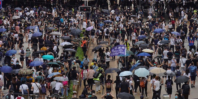 "Pro-democracy protesters march during a protest against Beijing's national security legislation in Hong Kong, May 24. Hong Kong's pro-democracy camp has sharply criticized China's move to enact national security legislation in the semi-autonomous territory. They say it goes against the ""one country, two systems"" framework that promises the city freedoms not found on the mainland. (AP Photo/Vincent Yu)"