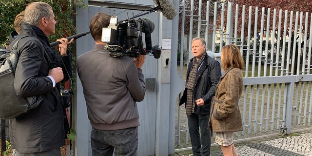 Cindy and Fred Warmbier speak to reporters outside the City Hostel Berlin, which is said to be an illegal money-maker for North Korea.