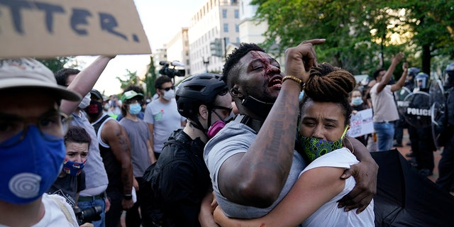 A demonstrator is injured as people protest the death of George Floyd, Saturday, May 30, 2020, near the White House in Washington. Floyd died after being restrained by Minneapolis police officers. (Associated Press)