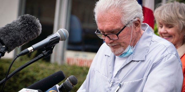 Manke became emotional while speaking during a press conference Monday at outside his barbershop in Owosso after a judge declined to sign a suspension order before holding a hearing. (Sarahbeth Maney/The Flint Journal via AP)