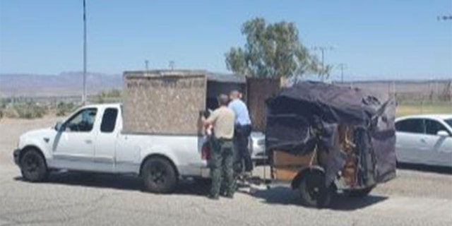 Deputies allegedly found five children in an unventilated crate attached to the back of a pickup truck in Needles, California, Wednesday. Temperatures were nearing 100 degrees. (Courtesy: San Bernardino County Sheriff)