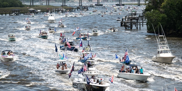 Boaters participate in the Make America Great Again parade May 24, 2020, in Charleston, South Carolina. A Facebook post noted the event, which was scheduled to begin at the U.S. Coast Guard station on the battery in Downtown Charleston and wind it's way up the harbor, was hosted by OSR Marine, a marine supply store. (Photo by Sean Rayford/Getty Images)