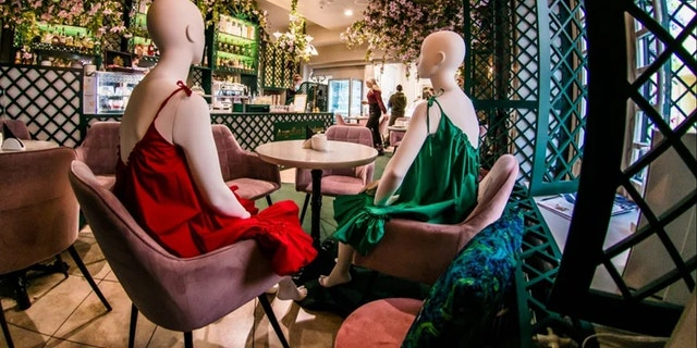 More than 60 mannequins modeling local designer's clothes from 19 boutiques are featured in dozens of restaurants and cafés in the city's Old Town Glass Quarter.