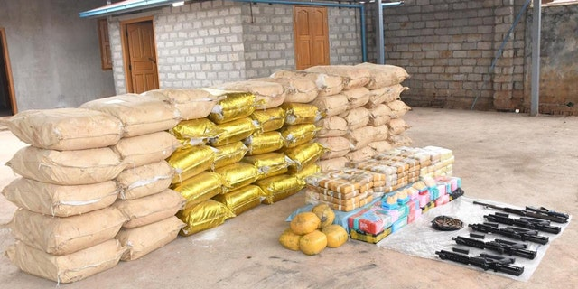 Weapons, ammunition, alongside bags of crystal methamphetamine and meth-laced yaba pills seized by Myanmar police and military are seen in this undated photo near Loikan village in Shan State, between February and April 2020 in what the United Nations Office on Drugs and Crime described as Asia's biggest-ever drug bust.