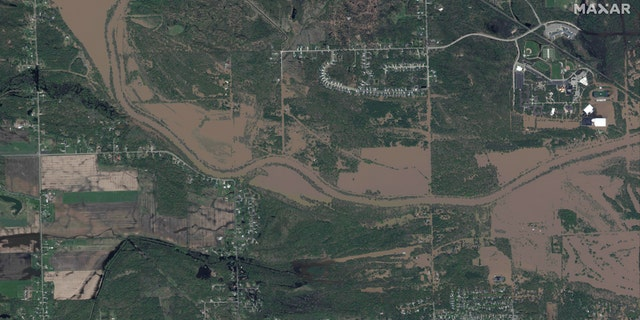 Flooding along the Tittabawassee River in central Michigan as seen in this satellite photo from Maxar on Thursday.