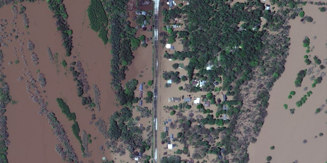 Flood residential neighborhoods can be seen in satellite images in central Michigan on Wednesday.