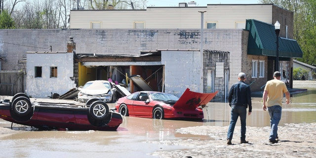 Cars are scattered and tipped over in downtown Sanford, Mich. after flooding along the Tittabawassee River on May 20.