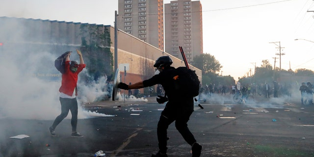 People clear the area after curfew Saturday, May 30, 2020, in Minneapolis.