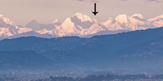 Mount Everest (arrowed) photographed from the Kathmandu Valley.