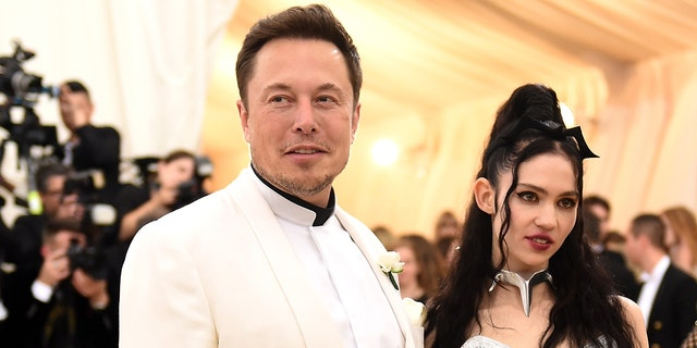 Elon Musk and Grimes attend the Heavenly Bodies: Fashion & The Catholic Imagination Costume Institute Gala at The Metropolitan Museum of Art on May 7, 2018, in New York City.