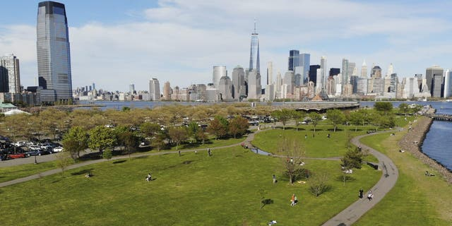 People enjoy the good weather while keeping their distance from one another at Liberty State Park in Jersey City, N.J., on May 2. (AP)
