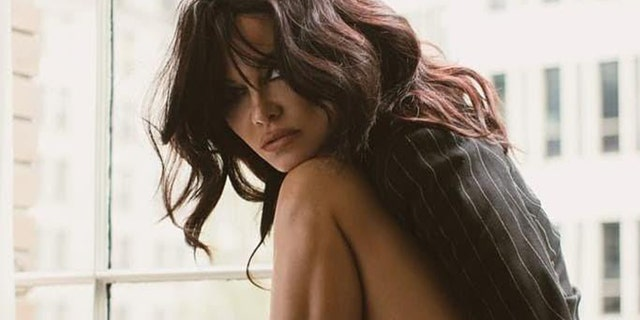 Pamela Anderson, photographed here with brunette hair, tells Fox News that she loves Playboy's 'girl's next door' vibe.
