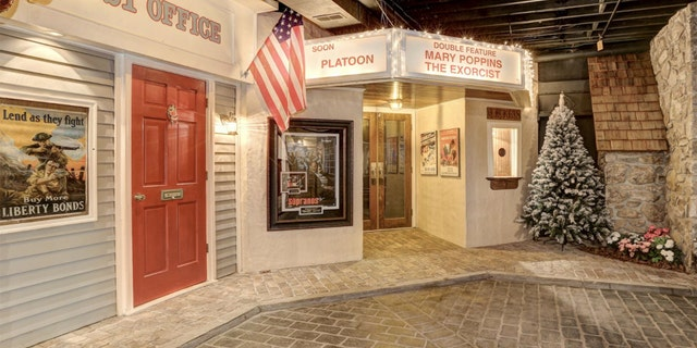"""The faux town also has a movie theater with a marquee showing """"The Exorcist"""" and """"Mary Poppins,"""" while real, life-size vintage cars line the streets. The decor is suitably festive, with pine trees, poinsettias and gingerbread men."""