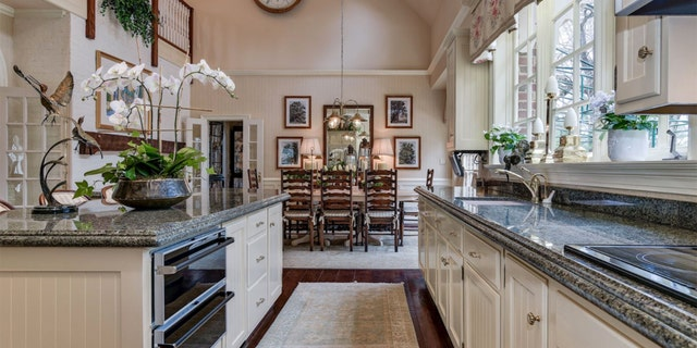 The kitchen and dining round out the intricate interior design.